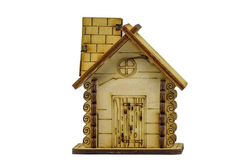 Maison en bois miniature d'isolement sur le fond blanc images stock
