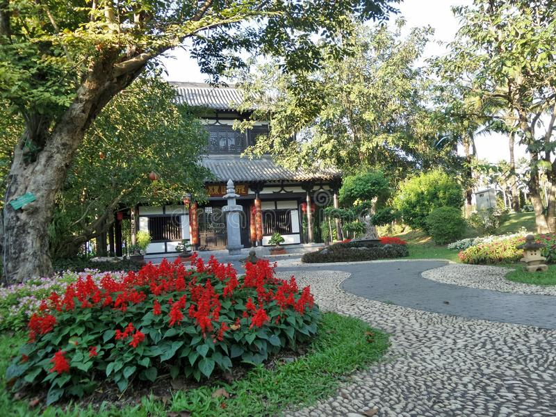 Maison et jardin de style chinois image libre de droits