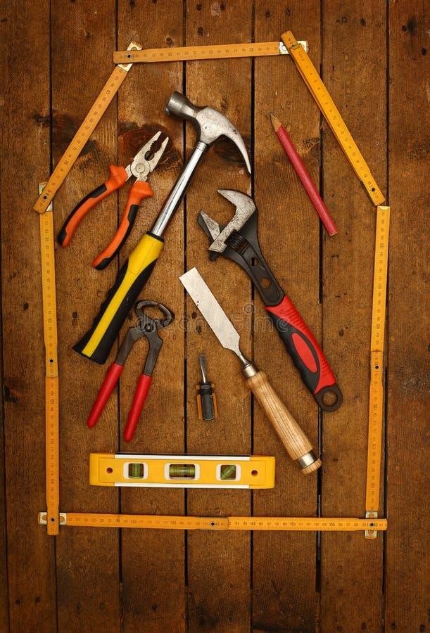 Maison et outils de critère photo stock