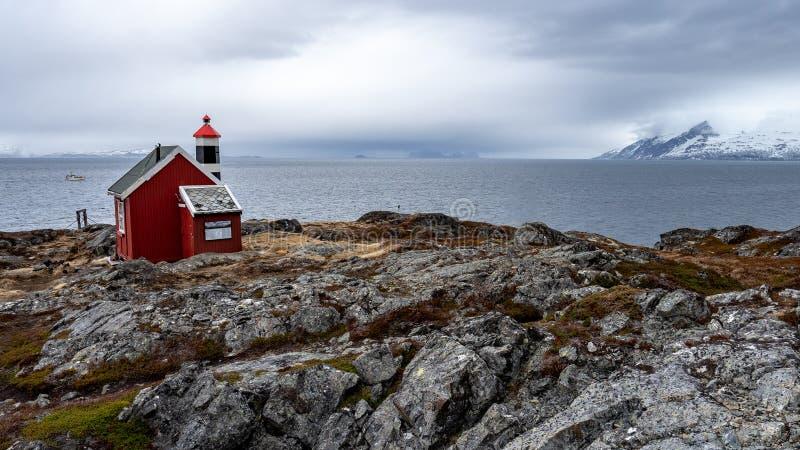 Maison et phare rouges photos stock