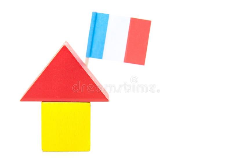 Maison stylisée avec le drapeau français photo stock