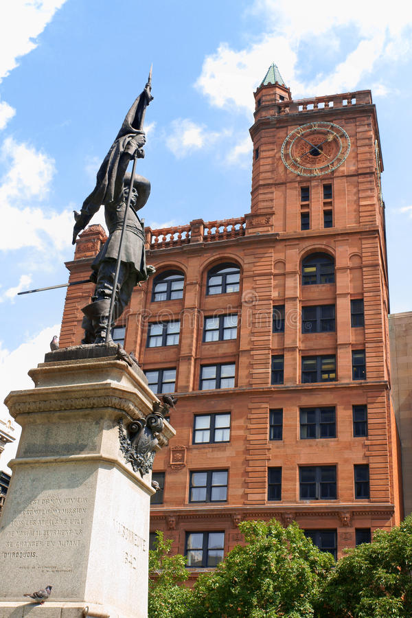 Maisonneuve monument and New York Life Building in Montreal, Can. Maisonneuve monument built in 1895 in memory of Montreal founder Paul Chomedey de Maisonneuve stock photography