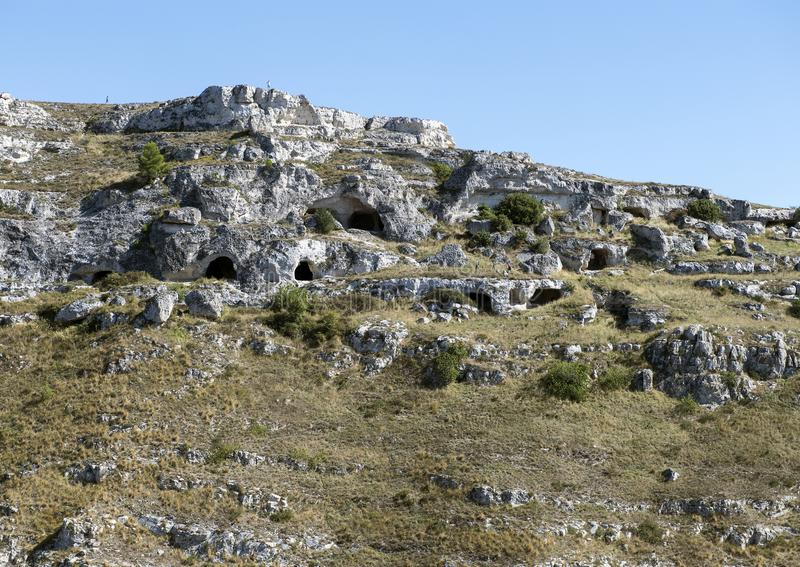 Maisons antiques de caverne à Matera, Italie image stock