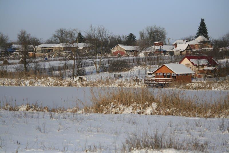 Maisons d'hiver image libre de droits
