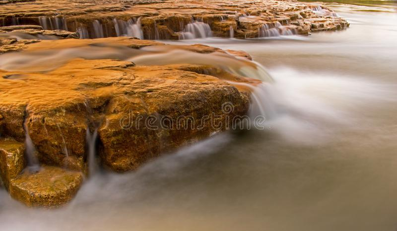 Maitland Falls Near Goderich, Ontario, Canada. Water is blurred by long exposure of this short waterfall on the Maitland River near Goderich, Ontario, Canada royalty free stock photos