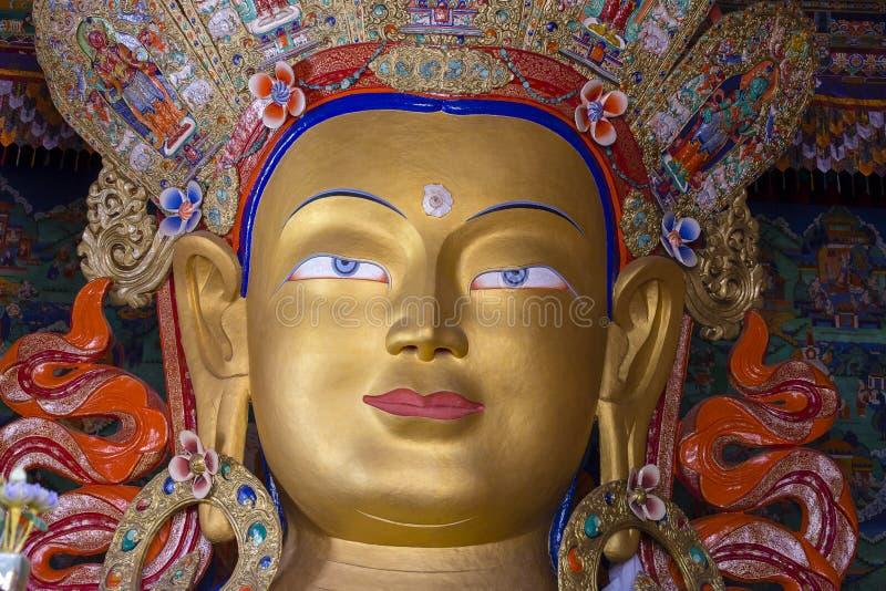 Maitreya菩萨的眼睛面对紧密  Thiksey Gompa Ladakh,印度 免版税库存照片