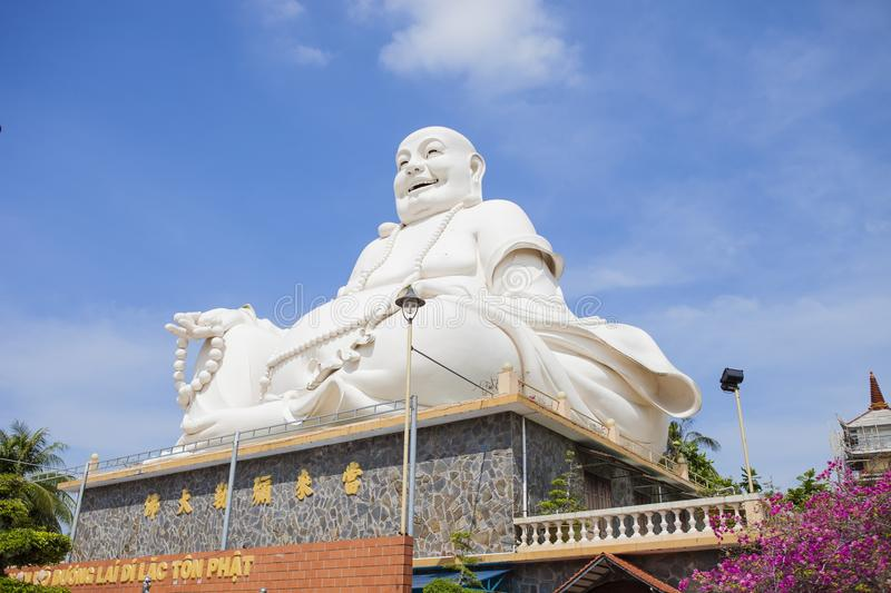 Maitreya Buddha statue located in the famous Vinh Trang pagoda in My Tho city, Tien Giang province, Vietnam.  royalty free stock images