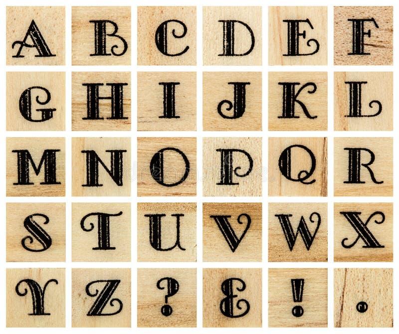 Maiuscola di alfabeto inglese, collage di scritto tipografico di legno isolato fotografia stock libera da diritti