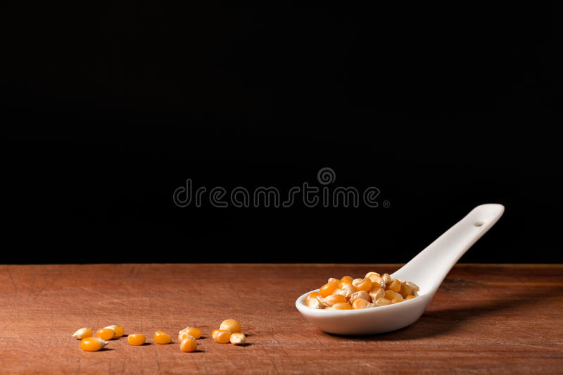 Maize on a spoons stock photo