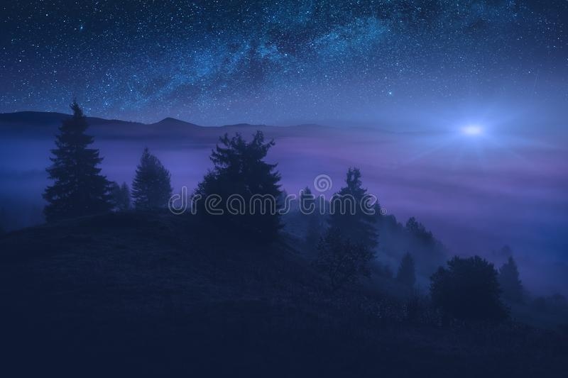 Majestic alpine valley at night royalty free stock image