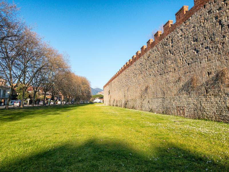 Majestic ancient medieval walls of Pisa with gardens, Tuscany - royalty free stock photography