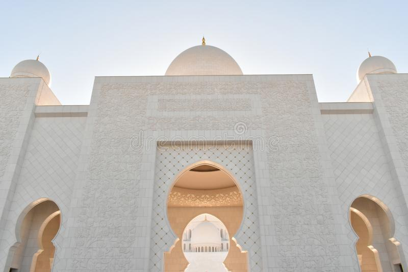 Majestic Arch Dome Entrance of Sheikh Zayed Grand Mosque. With dusk hue around the domes Islamic Architecture stock photos