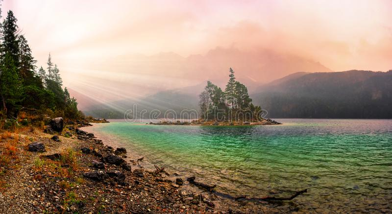 Majestic autumn sunrise on Eibsee lake. German Alps, Bavaria, Germany royalty free stock photos