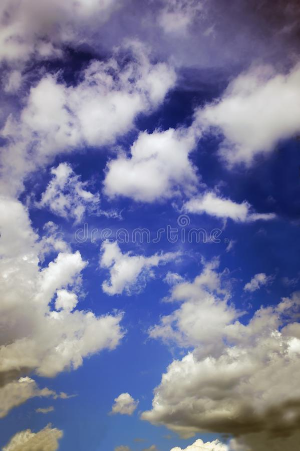 The majestic beautiful blue sky of sunset. Pre-threatening mood. Cloudy abstract background. Vertical photograph stock photo