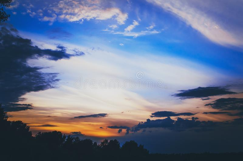 The majestic beautiful blue sky of sunset. Pre-threatening mood. Cloudy abstract background. The majestic beautiful blue sky of sunset. Prethreatening mood royalty free stock photography