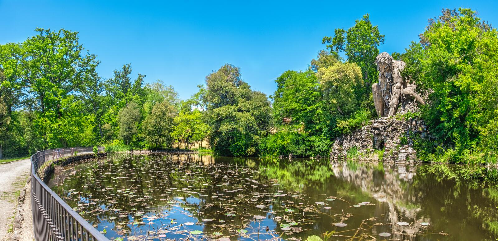 The majestic big statue of Colosso dell Appennino giant statue and pond in public gardens of Pratolino near Florence in stock images