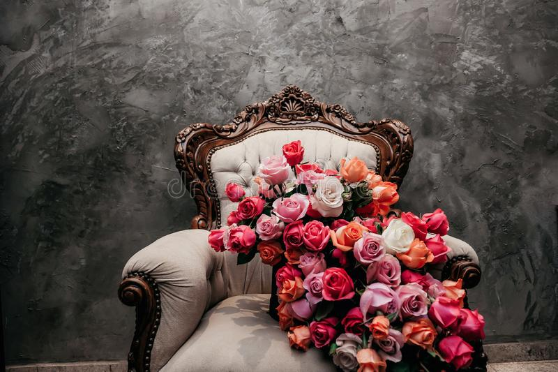 Majestic bouquet over a chair in close royalty free stock image