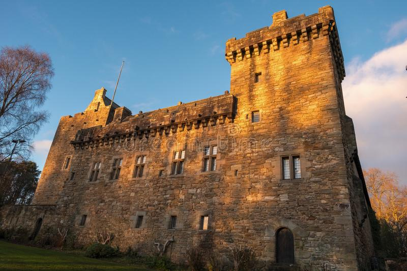 Majestic Buildings of Dean Castle Tower in Late Afternoon Sunlight in East Ayrshire Kilmarnock Scotland. Kilmarnock, Scotland, UK - November 26, 2018: The royalty free stock photography