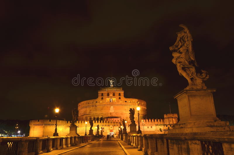Majestic Castle of Saint Angel over the Tiber river by night in Rome, Italy royalty free stock images