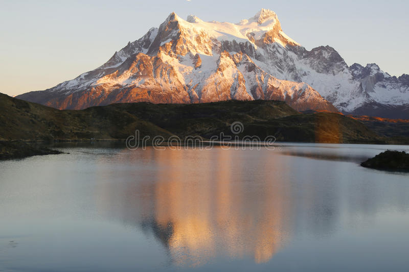 The Majestic Cuernos del Paine reflection during sunrise in Lake Pehoe in Torres del Paine National Park, Patagon royalty free stock photo