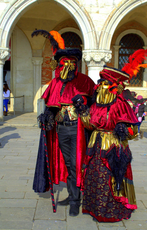Majestic disguised couple Venice royalty free stock photography