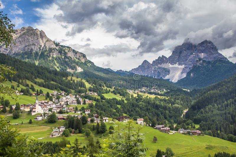 Majestic Dolomites Mountainous surrounding the villages of Colle Santa. Lucia and Santa Lucia Curch Italian: Chiesa di Colle Santa Lucia on a cloudy summer stock photos