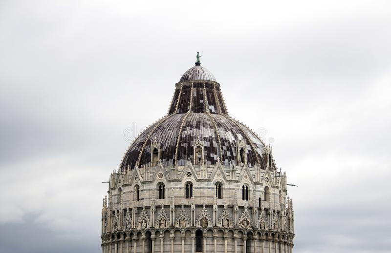 The majestic Dome Of Campo Dei Miracoli in Pisa, Italy. Nice clouds in background. The majestic Dome Of Campo Dei Miracoli in Pisa, Italy royalty free stock image