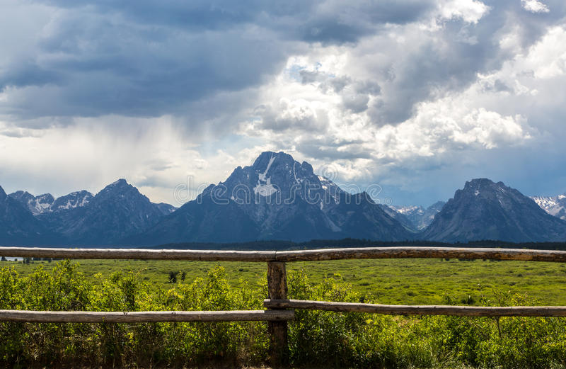 Majestic Grand Tetons. The Grand Tetons stand majestically behind a rustic fence stock photos