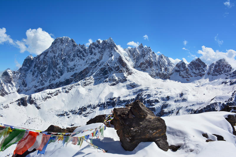 Majestic Himalayan mountains, Nepal. Big stone and tibetian pray royalty free stock images