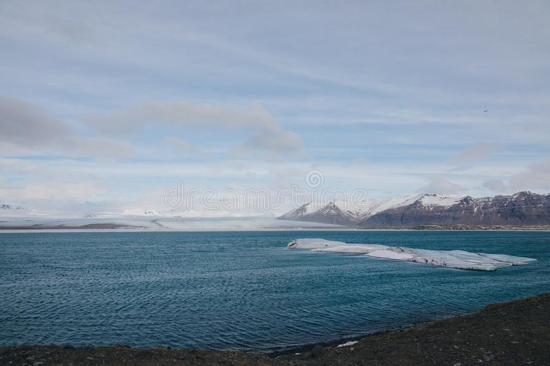 Majestic icelandic landscape with snow-covered mountains and ice in harbour,. Jokulsarlon Glacier stock photos