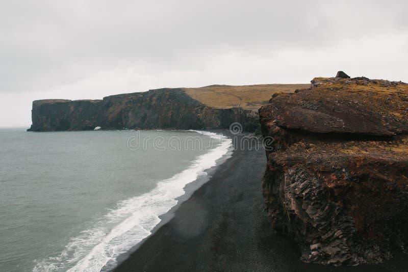 Majestic icelandic seacoast with black sand and cliffs, vik dyrholaey, reynisfjara. Beach, iceland stock photo
