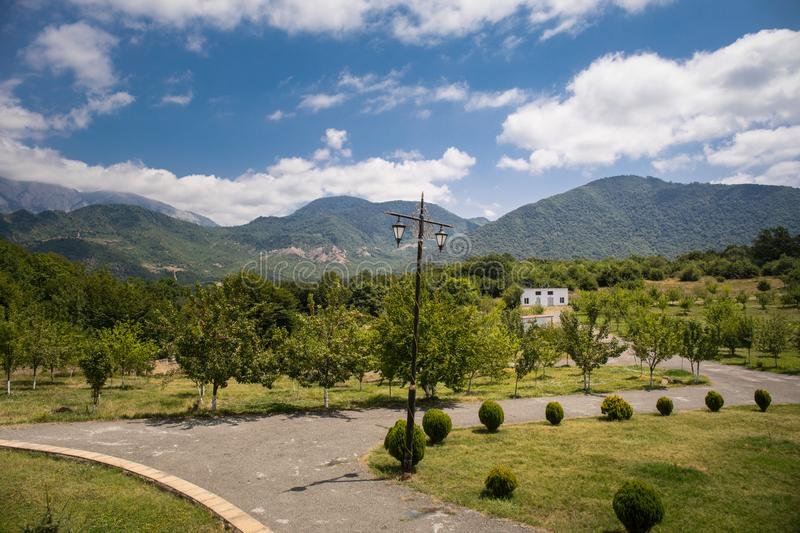 Majestic landscape of the mountains and forest in Caucasus at summer. Dramatic sky with clouds. royalty free stock photography