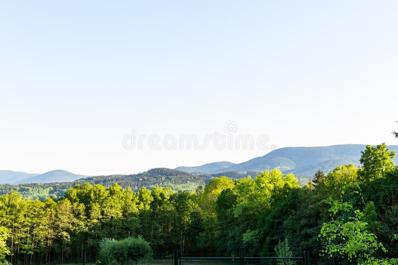 Majestic landscape of mountains and Meadow. Cycling mountain road. Misty mountain road in high mountains.. Cloudy sky with mount royalty free stock photos