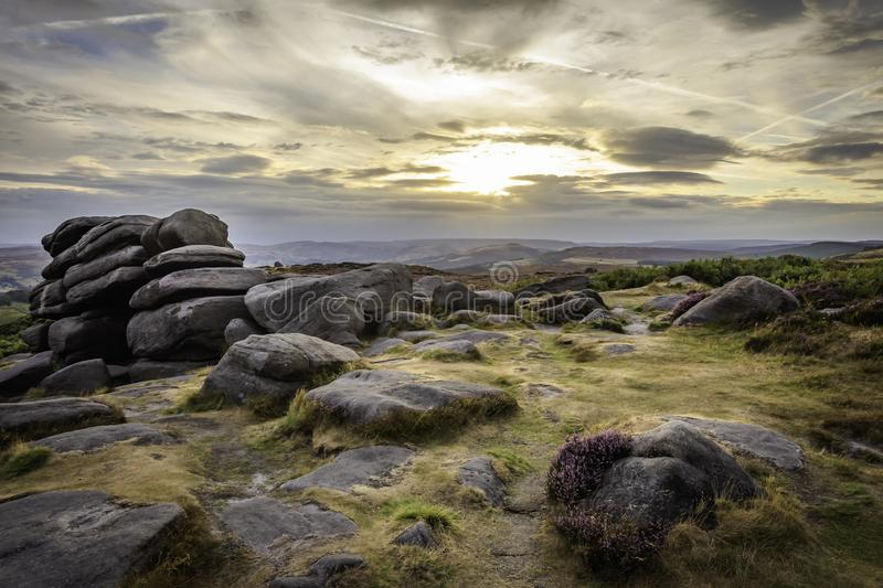 Majestic landscape of Peak District National Park, Derbyshire, Uk. Sunset over hill with boulders and moody sky above horizon.Idyllic scenery of british stock photos