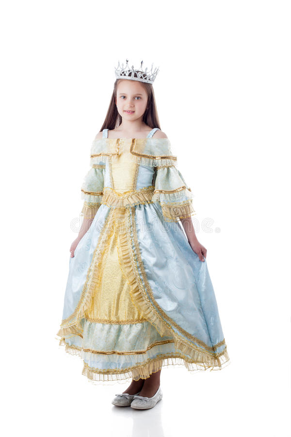 Majestic little girl posing in royal dress royalty free stock images