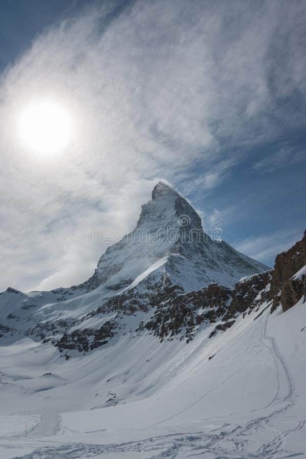 Majestic Matterhorn mountain in front of a partly cloudy sky royalty free stock photos
