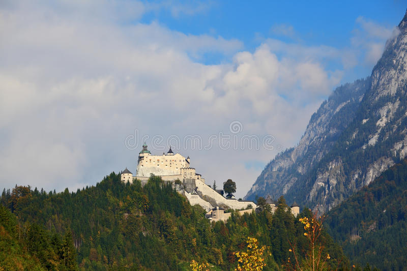 Majestic medieval Burg Hohenwerfen. The castle is situated on top of the mountain and surrounded by dense forest stock photo