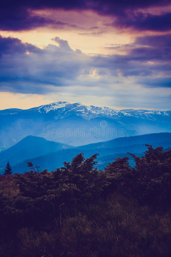 Majestic morning mountain landscape. Dramatic overcast sky. Filtered image:cross processed vintage effect royalty free stock photos