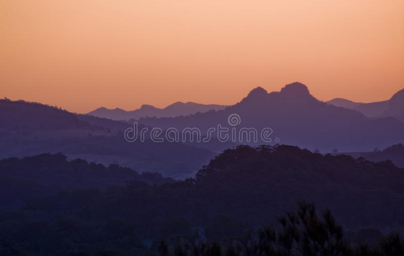 Majestic Nature at dusk. Hilly landscape at dusk majestically presented in natures colours thanks to atmospheric dust royalty free stock photo