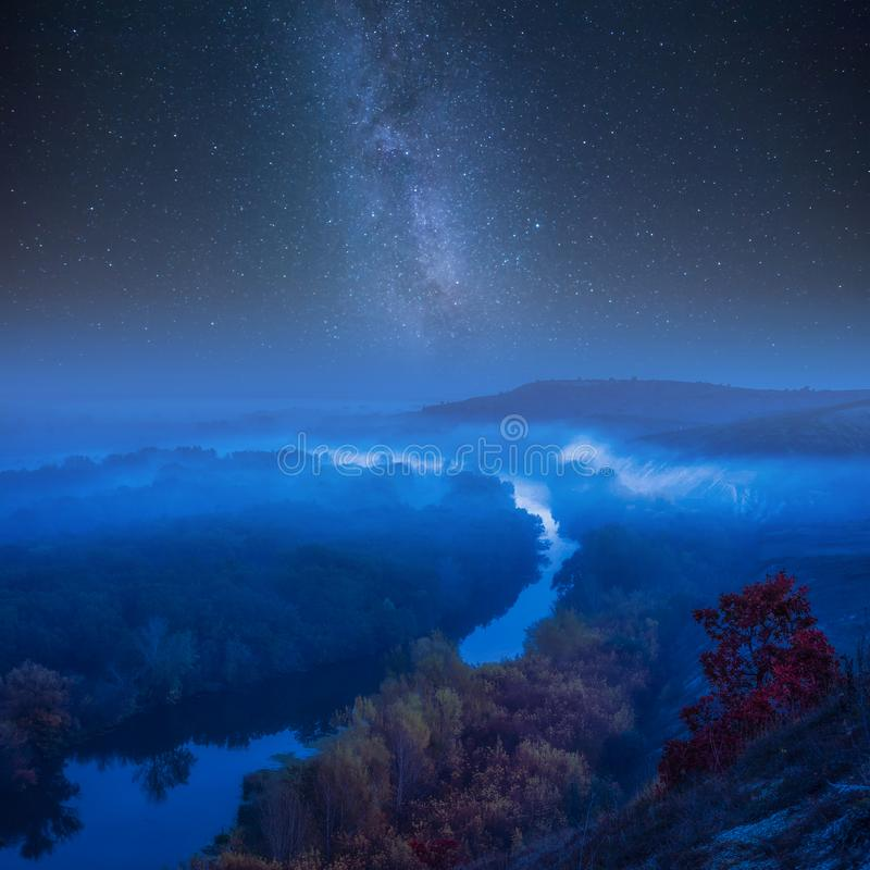 Night autumn landscape with galaxy stock image
