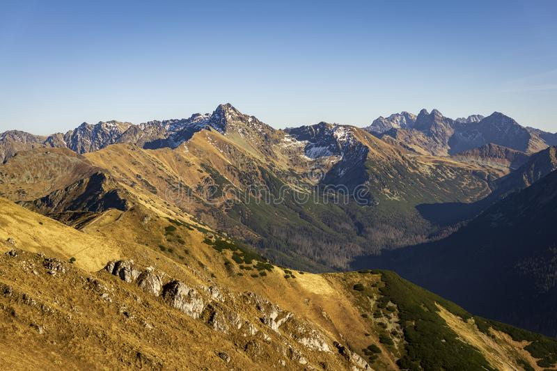 Majestic peaks of the Tatra Mountains in the autumn landscape.  stock photo