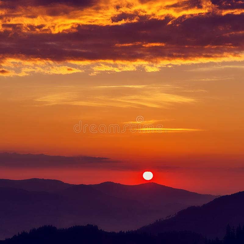 Majestic red sunset inth mountains. Colorful dramatic sky glowing sunlight. Amazing natural background. Wonderful summer scene. With morning sun. picture of royalty free stock images