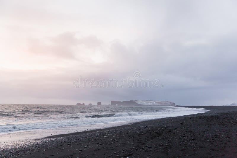 Majestic seacoast with wavy sea and cliffs, vik dyrholaey, reynisfjara. Beach, iceland stock photography