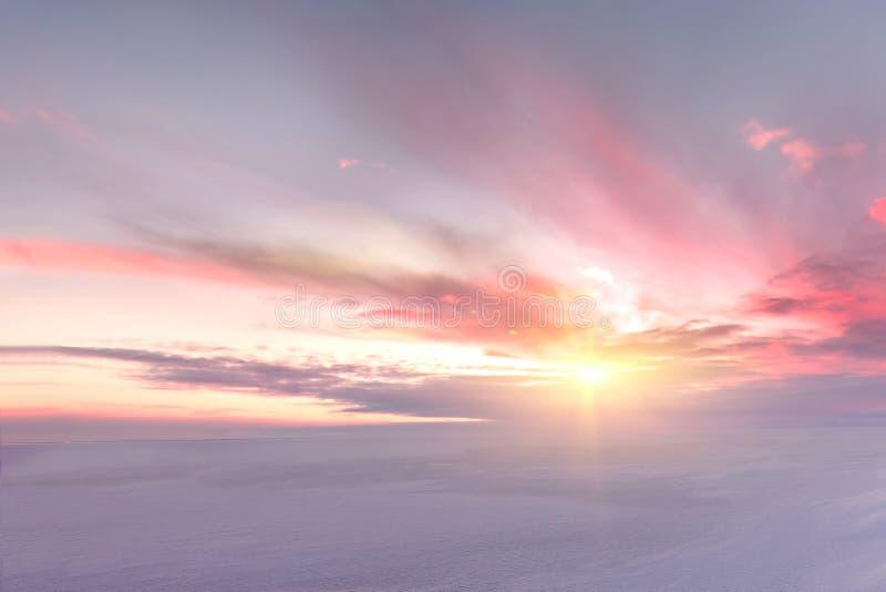 Majestic winter sunset over the Chudskoy lake royalty free stock images