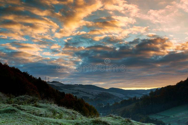 Majestic sunrise the mountains landscape. Beautiful autumn morning on the view point above the deep forest stock photo