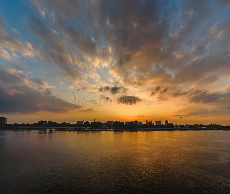 Majestic sunset over the river Scheldt in the Belgian city of Antwerp Antwerpen. With plenty of space for copy and text royalty free stock photos