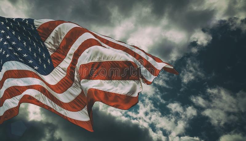 Majestic United States Flag against a dark background royalty free stock photography