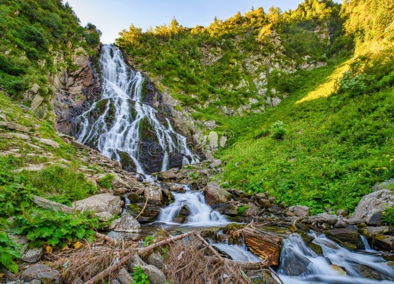 Majestic view of Balea Cascada waterfall in Fagaras mountains, Romania. Majestic view of Balea Cascada waterfall in Fagaras mountains near famous Transfagarasan stock photo