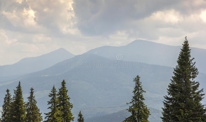 Majestic view on beautiful fog mountains in mist landscape. Dram royalty free stock photo