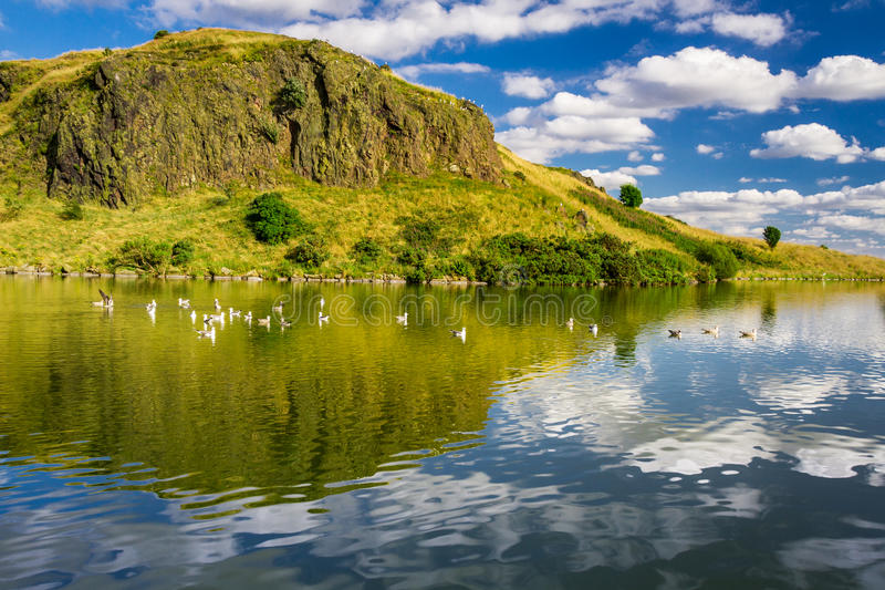 Majestic view of the hill reflected in a lake royalty free stock photo